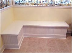 For eat-in kitchens that aren't quite big enough for a full table and chairs, DIY a banquette bench. | 31 Inexpensive Ways To Make The Kitchen Your Happy Place