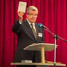 New Kazakh Bible Translation Featured at Convention and Open House. Gerrit Lösch of the Governing Body of Jehovah's Witnesses releases the New World Translation of the Holy Scriptures in Kazakh.