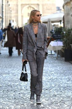 Stella stayed true to her sexy-meets-tomboy style in a plaid suit and Converse sneakers. She let her bra peek out from underneath her blazer, wore a bunch of Tomboy Fashion, Vogue Fashion, Fashion Week, Urban Fashion, Fashion Outfits, Tomboy Style, Street Fashion, Fashion Photo, Street Style Suit