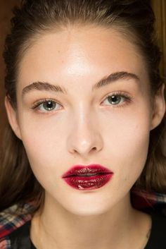 Giambattista Valli Val Garland created bold scarlet lips with a high-gloss finish at Giambattista Valli.