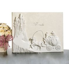 "This Fairytale Castle Guest Book is perfect for the ""Cinderella"" bride!  Features a horse and carriage on its way to the magical castle."