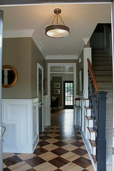 the floor, the wall color, the staircase, the white trim... so classy! :)