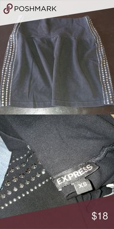 Express Studded Skirt Silver square studs going down each side. Mini skirt size XS from Express. Tighter waistband so it stays put ! Express Skirts