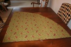 Tutorial on how to make a round tablecloth---she makes it easy!