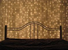 You can hang strings of lights up on the wall behind your bed and then cover that same wall with a see-through curtain. Wallah!  I just did it to my room...looks so awesome too ;-) <3