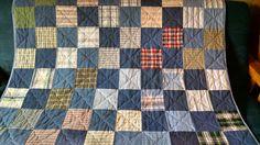 Repurposed denim and shirt quilt.
