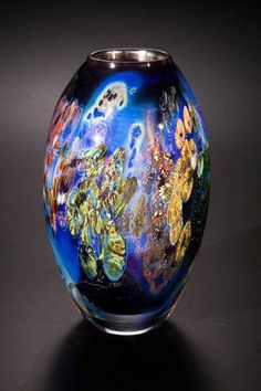 """Glass Artist Josh Simpson of Shelburne, MA (apparently no relation to Vollis Simpson of whirligig fame) does these intricate, multi-layered """"inhabited vases"""". Recently I saw one of his 2004 versions in the collection of The Huntsville (AL) Museum of Art. Also, REALLY like the """"Planets"""" shown on his web site: http://www.megaplanet.com/gallery2/v/planets/."""