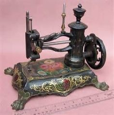 Antique sewing machine with stenciled base