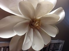 Large paper flower with seeing pattern tissue paper as center. Really cute.