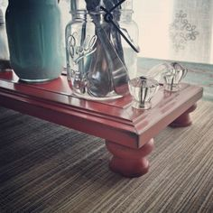 Centerpiece tray for our dining table.  Made from a drawer front, knobs for feet and vintage glass pulls.  Had to keep this one for me!  Made by Cabinet Doors & More