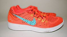 """Nike Lunarlon Sneakers. Orange with Turquoise Accent. Length - 11"""". Excellent- No visible flaws or wear, almost like new. Condition Definitions. 