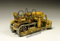 Type of Bull-dozer seen by kids that caught their interest to go up the sand dune and find the tread.
