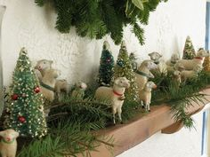 """Sharon Lovejoy ~ Dec. 20, 2012 ~ Her flock of little German Stick Sheep. """"I am thankful that they survived the big earthquake in December of 2003. They were lined up along the mantel in our Cambria cottage when the big San Simeon quake hit. All the sheep, the trees, and greenery shot across the living room and landed about 10' from the mantel. Some were broken, others lost their ears or legs, but these survivors are still a part of our family traditions."""""""