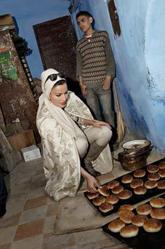 Her Highness visits the traditional souk in Fez, Morocco during her private visit 29/3/13. She was rocking the traditional Moroccan cape/burnoose, still dressing mono-chromatically. She loves to inject the local culture into her outfit.