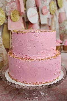 Glam Graduation Party Ideas - sprinkles of gold on this delicious pink cake