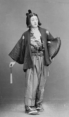 Portrait of Woman? with Face Makeup in Genroku Period Male Costume with Swords, Fan, and Straw Traveling Hat. About 1880's, Japan, by Ogawa, Isshin. Smithsonian Institution, Freer Gallery of Art and Arthur M. Sackler Gallery Archives