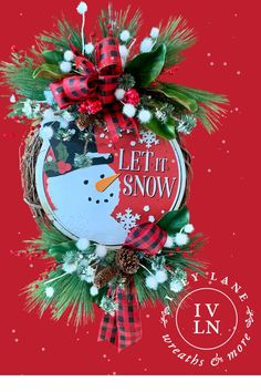 Let it Snow! This friendly snowman wreath is sure to bring you cheer throughout winter! Made with a mix of faux greenery, berry picks and snowballs for a fun mix that is perfect even after the Christmas decorations are put away.