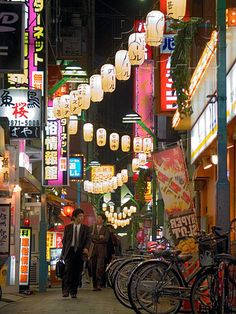 Japan - Businessmen roaming the festively lit backstreets of Kabukicho in Tokyo  - Photo by Photo Japan