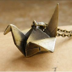 Paper Crane Necklace This adorable necklace is shaped like a paper crane, and adds a fun twist to any outfit. Brand new. ❌CURRENTLY OUT OF STOCK. I have more coming in soon!❌ Please do not purchase this listing; comment below, and I will create a separate listing for you! Jewelry Necklaces