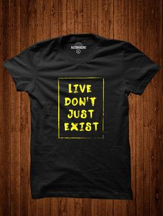"""Carpe Diem! This inspirational """"Live Don't Just Exist"""" unisex quote t-shirt is a thought-provoking clothing option that looks great when worn and carries with it a message applicable to all walks of life. Handmade in vivid detail, it features a 100% cotton t-shirt that is screen-printed with a brushed text ensconced within a frame. The effect is simple, yet so effective. Wear it at home or when you're on the go to keep that momentum pumping. This is an original MASTERMINDZMKT creation. Order…"""