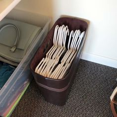 Keep loose hangers from falling to the ground and untangled in a magazine file. This way they're ready and easy to transport for laundry day. Keep the rest of the items on the closet floor in a storage bin or tote, making it easier to pull out from closet corners or clean behind.