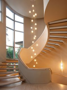 Lighting, Contemporary Staircase With Beige Wall Paint Color Also Comely Staircase Railing And Beauteous Staircase Lighting Design With Gorgeous Ball Pendant Lights Also Modern Windows Design Also Beige Laminate Floor: Enchanting Staircase Lighting Ideas