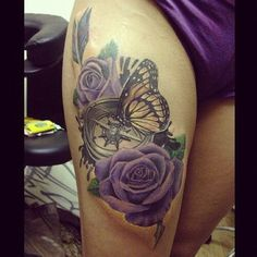 Rose clock butterfly thigh tattoo