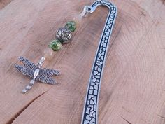 A personal favorite from my Etsy shop https://www.etsy.com/listing/535024605/dragonfly-bookmark-handmade-bookmark