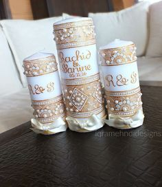 Gold and Ivory intricate patterned candle set
