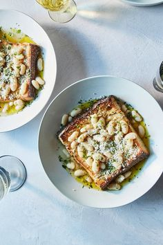 NYT Cooking: A simple dish of creamy, thin-skinned beans and broth on toast is easy to make, and a comfort to eat alone or feed a crowd. If you make the beans ahead of time, they can keep in the fridge for 3 days, but may need a splash of water added when Parmesan Rind, Eating Alone, Vegetarian Recipes, Healthy Recipes, Food Porn, Soups And Stews, The Best, Sandwiches, Food Photography