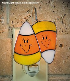 "Candy Corn Cover  Switchables Night Lights  Introducing night lights like you've never seen before ... change your night light to suit your mood or the season! Each Switchables light catcher is beautifully hand made from quality stained glass, and measures approximately 3-1/2"" by 3-1/2"" (varies slightly by design)."