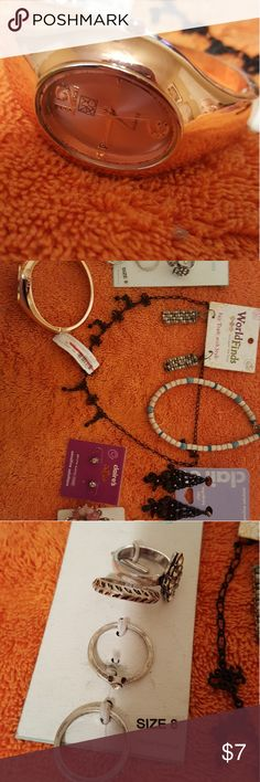 Lot of Costume Jewelry Lot of mostly new costume jewelry! One watch, 5 rings, one pair of clip on earrings, 2 pairs of earrings, and 2 necklaces. Jewelry