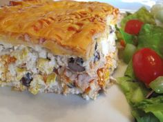 Easy Mexican Lasagna.  Cheesy, healthy, chicken enchilada goodness that might even be kid friendly.