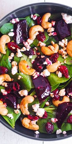 Beet Salad with Spinach, Cashews, Cranberries and Goat Cheese with honey, lemon and olive oil dressing. #healthy