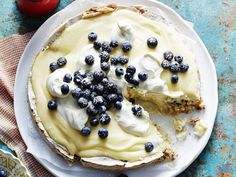 Topped with lemon curd, whipped cream and blueberries, this almond meringue cake is a show-stopper.