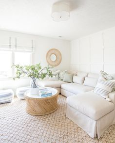 Southern Home Interior Bright and white den area with large L-shaped Pottery Barn sofa, rattan. mirror, greenery, cane coffee table, and throw pillows. Home Decor Inspiration, Home Decor Accessories, Pottery Barn Sofa, Cheap Home Decor, Home Decor, House Interior, Living Room Design Decor, Living Decor, Minimalist Home Interior