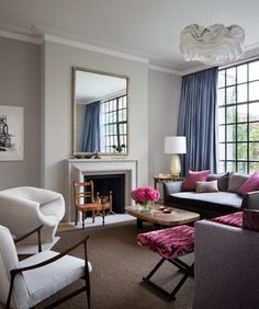 Pale gray walls, hot pink accents, but of course!
