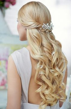 Tousled, long curls and a beautiful barrette, it's easy and very bridal in style.