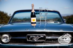 Drove to the top of a hill -- time to pop a bottle of pink Veuve Clicquot champagne! © Bowerbird Photography 2013; Engagement Photography with vintage 1966 Mustang convertible, San Francisco.