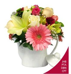 Tea Time Delight flowers arrangements in South Africa  A ceramic teapot containing a mix of seasonal blooms.