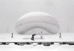 Snow falls on Anish Kapoor's Cloud Gate sculpture in Millennium Park in Chicago