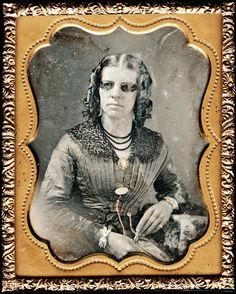 ca. 1850, [daguerreotype portrait of a woman with darkened eyeglasses]