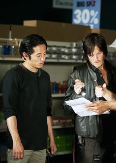 Steven Yeun & Norman Reedus filming a scene for The Walking Dead 4x01 Thirty Days Without an Accident
