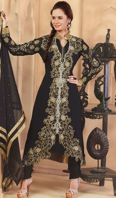 Lend an absolute charismatic look dressed in this black georgette embroidered churidar suit. You could see some fascinating patterns accomplished with bead, moti, resham and stones work. #EveningWearCollection
