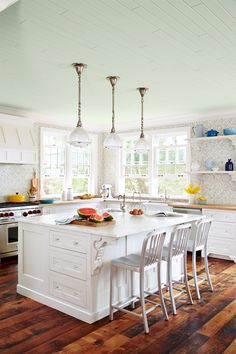 The country kitchen's painted ceiling gets a fun new spin by forgoing traditional blue in favor of a soft shade of green.