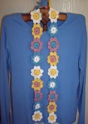Crochet Daisy Chain Scarf-- maybe for some of the little girls I babysit :)