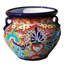 Use beautiful handpainted Spanish ceramic pieces - bowls, pitchers, serving platters - they come in all the right color combinations! But keep the linens solid - no extra patterns here! You could use lemons or oranges to hold the placecards, by the way...