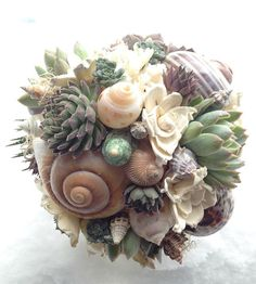 PERFECT!!! My favorite things! Succulents, seashells and sola flower bouquet. Wedding flowers. Beach bouquet.