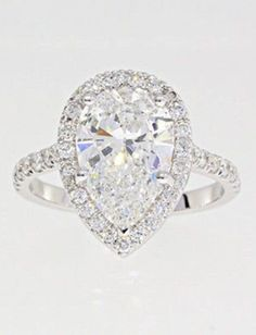 Halo Diamond Ring // L.O.V.E.  i had one like this once  but i sold it...i could just kick myself..:)