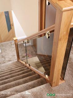 Oak staircase renovation incorporating bronzed glass